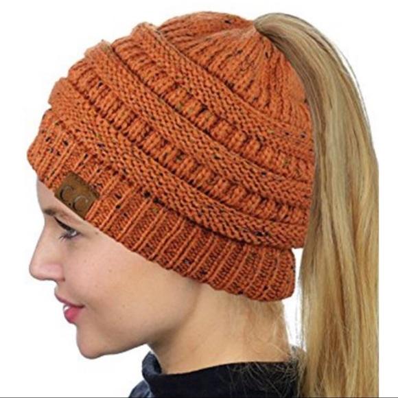 f172ccc385a Messy Bun Ponytail CC Beanie Hat. Orange